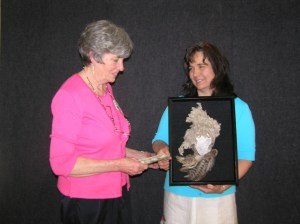 GFAMF Chair Fay Morrisson gives artist Wendy Rowland the People's Choice Award at last year's festival.