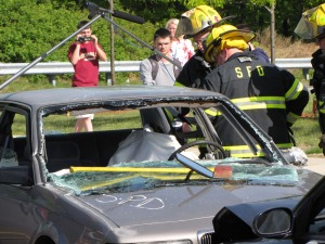 Shrewsbury firefighters participate in a mock car crash at Shrewsbury High in 2010.